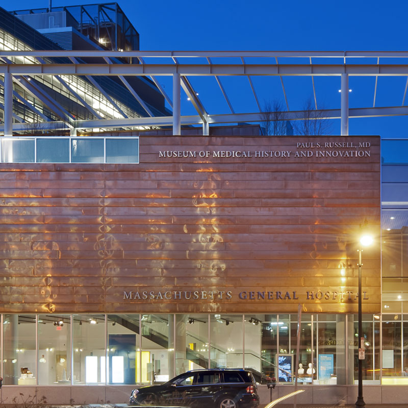 Close up of museum name on Copper and glass museum building in twilight