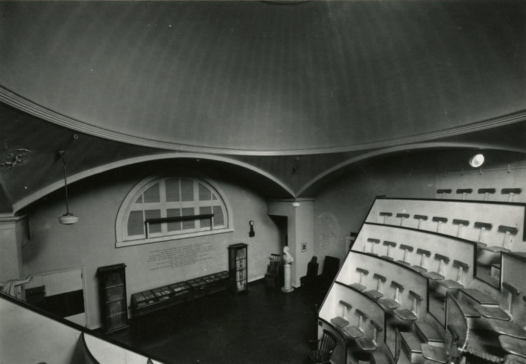 B&W photo of Ether Dome amphitheater, view from right on steps looking down to front.